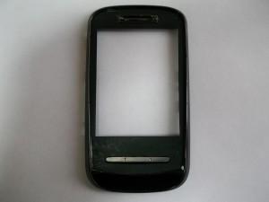 Убираем остатки стекла и скотча с корпуса сотового телефона Fly E200