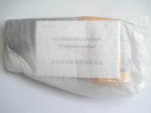 Упакованный в тонкий поролон бесконтактный термометр