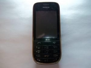 Сотовый телефон Nokia 202 с хрипящим динамиком