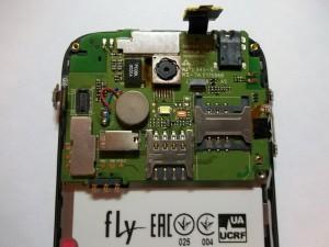 Шлейф тачскрина и дисплея в сотовом телефоне Fly IQ4404